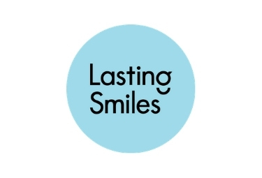 Lasting Smiles Logo, Light Blue circle, Black Lettering